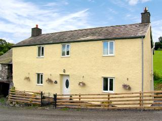 TY NANT, pet friendly, character holiday cottage, with open fire in