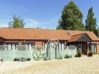 STABLE COTTAGE, pet friendly, character holiday cottage, with a garden in Necton