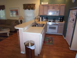 Fully equipped kitchen with bar seating