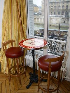 Sit at our bistro table and watch the Parisian life