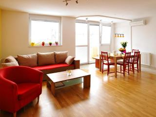 Living-room with sitting area for 7 people. Air-condition. Sunny, bright, heart of the apartment.