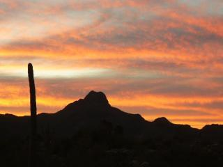Sunset behind Tucson Mountains from our roof deck