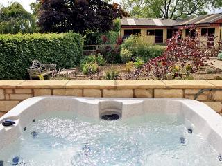 BECKHILL COTTAGE, pet friendly, country holiday cottage, with hot tub in
