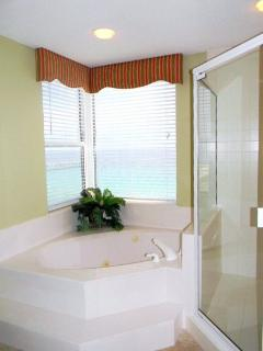 Master Bathroom Tub with a View of the Gulf and separate Shower