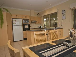 Modern spacious kitchen and dining area with full cooking facilities and dishwasher.
