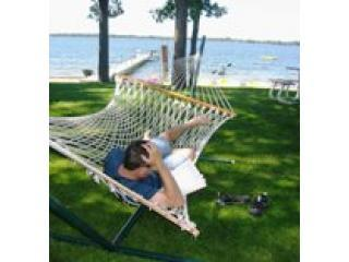 Doug reading and relaxing in hammock by the lake