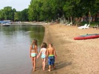 walking on beach-kayaks