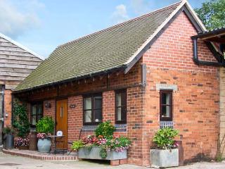 THE DAIRY, romantic, character holiday cottage, with a garden in Leighton, Ref