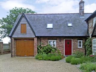 THE HAYLOFT, pet friendly, character holiday cottage, with a garden in