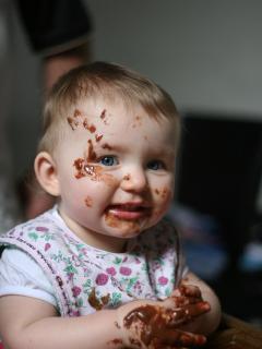 Aloise enjoys her 1st birthday with one of Jabinas chocolate cakes