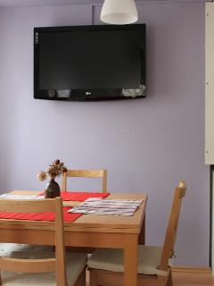 dinining area with big LCD TV