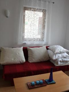 expandable sofa-bed in living room (2 guests can sleep)