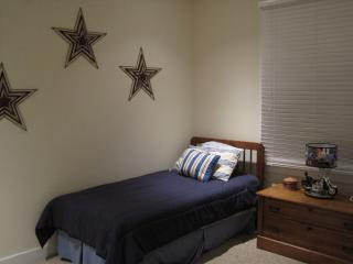 Twin beds in first floor bedroom adjacent to bath