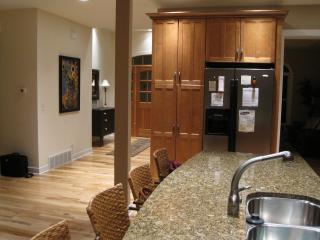 Use the large granite island for cooking, serving or eating.  There is lots of kitchen storage.