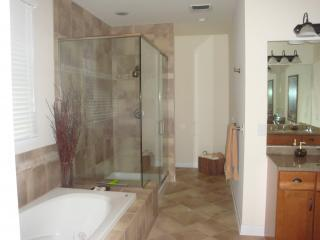 On the first floor, the master bath featured a large glass walled shower and jacuzzi tub.