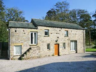 THE OLD STABLES, pet-friendly, character holiday cottage, with a garden in
