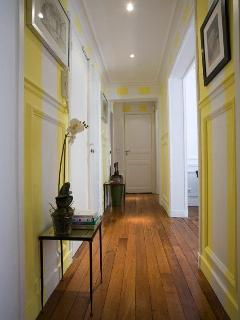 Cheerful striped corridor to bedrooms