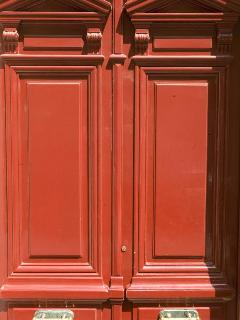 Parisian luxury awaits behind the red doors