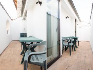 Both bedrooms open onto long balcony, overlooking pedestrian, mediaeval streets