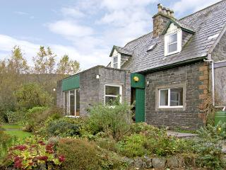NETHER BARR FARMHOUSE, pet friendly, character holiday cottage, with a garden in Newton Stewart, Ref 492
