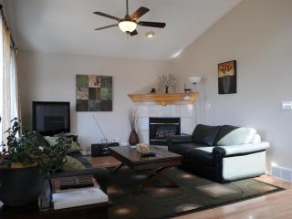 Living room with Vaulted Ceiling, hardwood flooring.