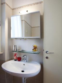 Two bathrooms next to bedrooms downstairs plus an addtional service w.c at entry level