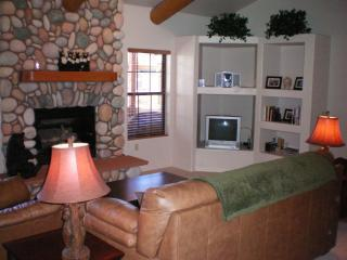Family room with fireplace and flat screen cable T.V.