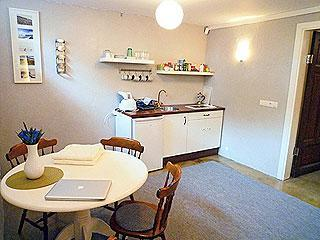 The kitchenette has a two ring ceramic cooking unit, a refrigerator and a dining table for four.