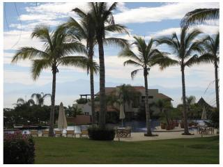 Beautiful ocean view condo in gated community just minutes away from beach