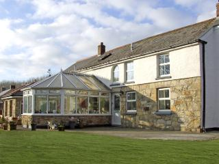 CHAPEL GREEN, pet friendly, character holiday cottage, with a garden in, Trelowth