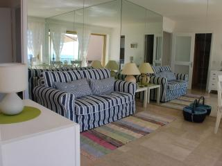 Living room, looking at floor to ceiling mirror
