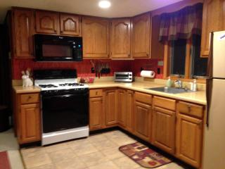 Kitchen – fully equipped with 4-burner gas stove & full-size microwave oven