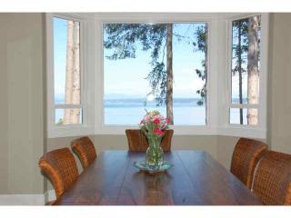 Kitchen can seat 11 while enjoying panoramic views of Port Susan Bay & Mtns