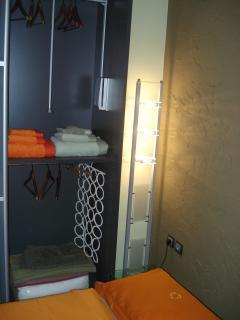 Wardrobe with sliding glass doors