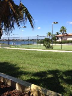 Lighted Tennis Courts & Lake View