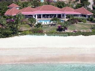 All 4 bedrooms have double- sea vistas, an open onto a natural stone terrace. VG DRE, Virgin Gorda
