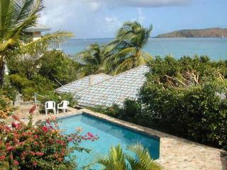 Right on the beach, a few steps from the water's edge. Unique two-story villa. VG LIL, Virgin Gorda