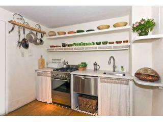 Kitchen with dishwasher, large refrigerator (not seen), coffee maker