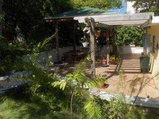 You\'ll love our patio, with weather protection, beautiful plantings