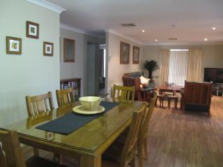 Spacious open plan dining/lounge room with modern country furnishings.