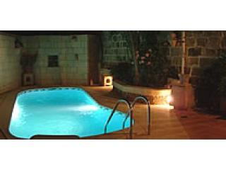 Pool area at night.