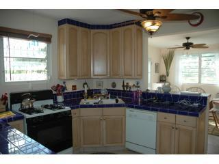 VDM's kitchen is fully loaded and open to the dining room on one side and living room on the other.