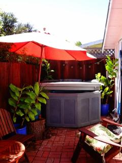 Private hot tub in enclosed back patio