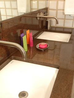 "Double sink with ""Tobacco"" granite countertop"