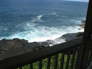 Waves crash on the cliff under the lanai