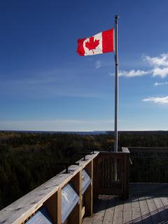 The Canadian Red Maple Leaf flies proudly atop the tower.