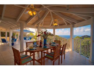 Outdoor dining area for 8, with fans and spectacular sunset views