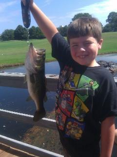 A guest's son fishing off the dock