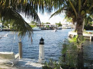 The dock and the extremely wide waterfront. Watch the yachts go by while in the pool or hot tub.
