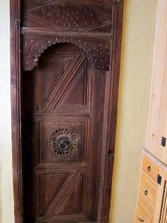 antique door leading to Herakleia bathroom